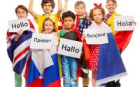 Group of seven happy kids wrapped in flags of USA and European nations, greeting each other in different languages, isolated on white