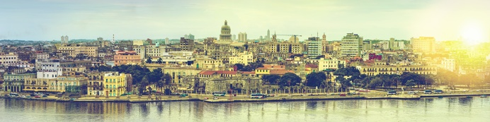 Wide panorama over Havana in Cuba with sun flare and toned effect